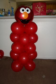 The Elmo Balloon column by J'OK Party Planning. Cost about $4. You could make arms with either long balloons or even streamers and a cut out of his hand to hold a sign. Balloon and many other Sesame Street items found at my local Dollar Tree. Cutouts, sandwich Elmo face cutter, wrapping paper and more there.