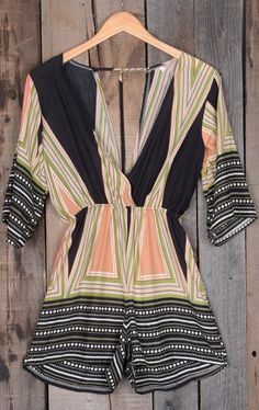 This romper is in it to win your heart! And we bet it's winning! We love the deep v neckline look and the elastic waist! It's all so summery and flattering!