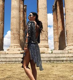 Aureta Thomollari Shares Her Athens Travel Diary: Her trip to Athens consisted of a toucan clutch, shiny oversized glasses and a yellow-green patterned jumpsuit. In collaboration with TUMI. -- Parthenon in Greece | coveteur.com