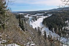 Snowshoeing on the Snagmore Trail above the Elbow River Valley near Bragg Creek in Kananaskis Country, Alberta, Canada