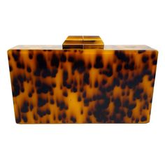 A hard-shell clutch I can actually afford.  It's $100 (as opposed to the $3000 that I've seen for others).   [Tortoise Shell Clutch]
