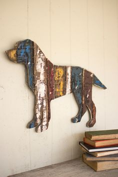 """Made from a variety of reclaimed wood, this friendly wall piece boasts rustic and aged beauty that is sure to charm art and dog lovers alike. 26"""" x 18""""t"""