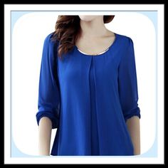 NWT Jewel Royal Blue Bar Necklace Blouse Super pretty Jewel tone blue! It has a gold tone bar necklace attached! Very classy loose fit top! This is stunning! Bouitque Tops Blouses
