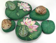 Hand painted frogs on lily pad rocks - from Italian artist Ernestina Gallina of Pietrieve  http://thegardeningcook.com/frogs-in-the-garden-cute-accents/