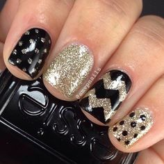 Simple black and gold skittles mani using @opi_products My Favorite Ornament and @essiepolish Licorice. Chevrons created with @teismom #nailvinyls. Topped with @glistenandglow1 #hkgirltopcoat. by...
