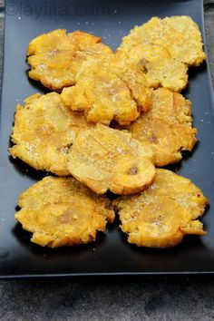 Easy recipe for homemade patacones or tostones, a popular Latin American appetizer or side dish of thick green plantain chips.