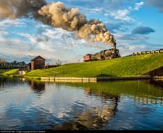 Good morning Cumberland! A Western Maryland helper locomotive and crew enjoys the warm, sunrise light as they make their way along the C&O canal basin toward the depot in downtown Cumberland, where they'll tie on to a coal drag headed for Frostburg and points west.