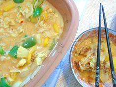 One-Pot-Asia-Reis aus dem Römertopf mit Kokosmilch und Ananas