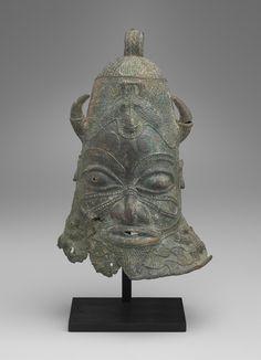 ~ Osun Bell Head. Date: A.D. 13th–15th century Place of origin: Lower Niger Delta, Guinea Coast, Nigeria Culture: Lower Niger Delta Medium: Copper alloy