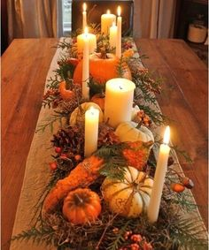 Fall tablescape with pumpkins and candles.