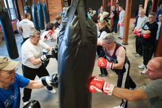 Fight Parkinson's: Exercise May Be The Best Therapy. Participants in a boxing class designed specifically for people with Parkinson's disease at Fight 2 Fitness gym in Pawtucket, R.I.