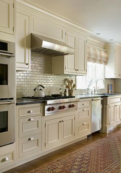 A classic New England kitchen ~ Dean Poritzky. The pretty subway tiles would look nice against a contrasting black range.