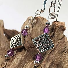 Handmade silver earrings with Celtic knot charms and faceted amethysts. A perfectly delightful gift idea for someone you love! Links to the matching set are available in the listing too. Silver Charms, Silver Earrings, Dangle Earrings, Gemstone Jewelry, Unique Jewelry, Amethysts, Matching Set, Celtic Knot, Money Tips