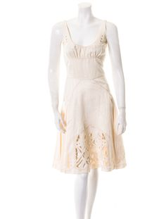 Zac Posen Dress  Cream A-line dress with tonal stitching, cutout detail, slash pockets, pleats at skirt and hidden zip closure.