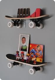 Hubby's old skateboards made the move; perhaps they can be shop shelves!