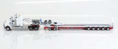 Drake Trailer Combinations : Kenworth C509 with Drake 2x8 Dolly and 5x8 Swingwing Trailer Red and White