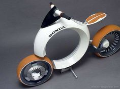 "Honda Cub Motorcycle concept vehicle, powered by a hydrogen fuel cell. (looks more like a ""rolling doughnut"")"