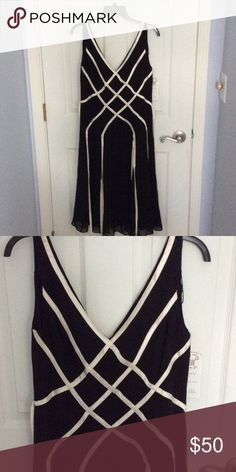 """Adriana Papell Black dress crisscross design NWT Nice dress for a special occasion.  The white """"ribbons"""" below waist are not attached and just flow.  Fun! Adrianna Papell Dresses"""
