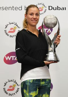 ♔♔Angelique Kerber of Germany poses with the DDF Year-End World trophy during day 3 of the BNP Paribas WTA Finals Singapore at Singapore Sports Hub on October 2016 in Singapore. Angelique Kerber, October 25, Finals, Singapore, Germany, Poses, Sports, Figure Poses, Final Exams