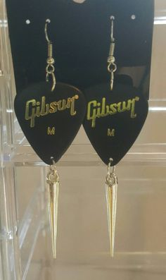 Check out this item in my Etsy shop https://www.etsy.com/listing/287673625/gibson-guitar-pick-dangle-earrings
