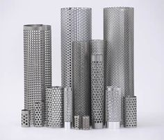 Several different kinds of perforated filter tubes stand on the white background.