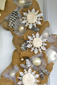Day #7 12 Days of Door Decor- Burlap and Snowflakes | FYNES DESIGNS - Please consider enjoying some flavorful Peruvian Chocolate this holiday season. Organic and fair trade certified, it's made where the cacao is grown providing fair paying wages to women. Varieties include: Quinoa, Amaranth, Coconut, Nibs, Coffee, and flavorful dark chocolate. Available on Amazon! http://www.amazon.com/gp/product/B00725K254