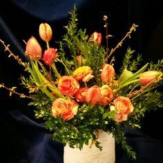 Local seasonal tulips, forsythia, boxwood and ranunculus.