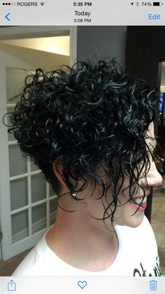 Blue black col, on natural curls with over directed layers.