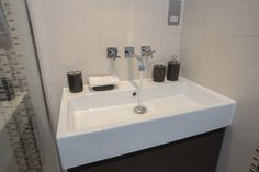 Single Vanity With Extra Wide White Sink