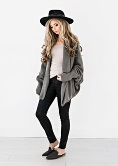 This cardigan is here to open up a whole new world of cozy. JessaKae, New Arrival, Cardigan, Comfy, Long, Bunched, Dark Sage, Cardi, Detail, Womens Fashion, Womens Style, Style, Fashion, Outfit, Shoes, Mules, Grey, Jeans, Flats, Hat, Felt Hat, Black, Trend