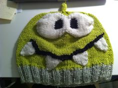 Everyone who has an iPhone has it permanently glued to their hand. Anyone who has played Cut The Rope knows this guy. Om Nom! This is a hat that I created to look like everyone's favorite monster.     Yarn: Sugar and Cream 100% Cotton