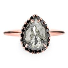 1.34 Black Diamond Pear Halo Engagement Ring, 14K Rose GoldThe ring features a beautiful unique pear shaped rose cut black diamond set in a halo setting. The diamond is a top quality natural, un-enhanced black diamond. The diamond is tr...