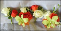 orange, green & white rose and orchid corsage