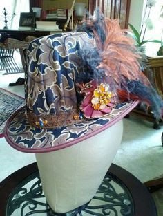 Brocade and silk man's Elizabethan tall hat.