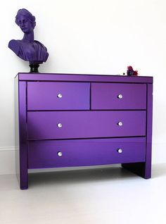 Serenity Purple Glass Chest Of Drawers from notonthehighstreet.com  I like the contemporary lines mixed with modern, bright colors.