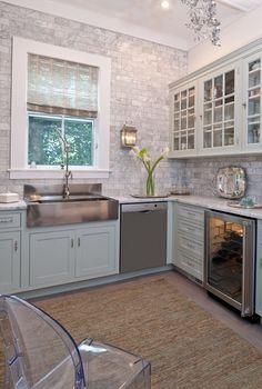 Carrara Marble tiles on wall, apron front sink - German silver sink, Waterstone Traditional Style Gantry Faucet, Robins egg blue cabinets traditional kitchen by Town & Country Kitchen and Bath