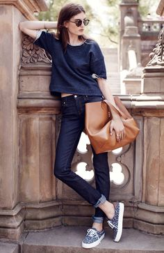 Madewell Alley straight jeans worn with raw-edge crop sweatshirt