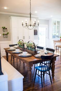 A modern farmhouse dining room might just be the dining room design of your dreams. A farmhouse dining room is a gorgeous dining room design that has a very bright tone. It is a combination of a traditional dining house… Continue Reading → Farmhouse Dining Room Table, Elegant Dining Room, Dining Room Design, Dining Room Furniture, Kitchen Dining, Kitchen Decor, Dining Rooms, Room Chairs, Fireplace In Dining Room