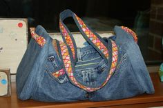 """Two pair of my husband's jeans equal one new bag for me!!  Pattern is """"Denim Duffle"""""""