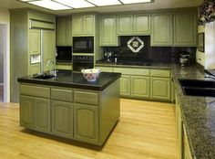 Pale Green Kitchen Cabinets With Green Granite Countertops And Green Island
