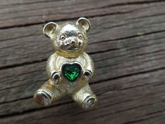 Vintage Bear Pin, Signed Avon, Gold Tone with Green Rhinestone Heart, Excellent Condition Ask a Question    $6.00 USD   Only 1 available