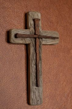 This rustic wooden cross is a handmade original design. It is made from reclaimed barn wood from the Pacific Northwest. On the face of the