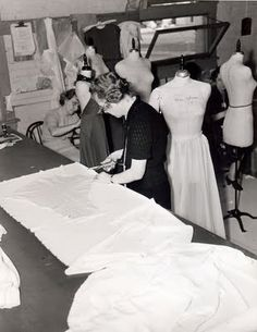 Cutters and fitters hard at work in the MGM wardrobe department's work room.