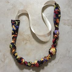 Statement Fabric Teething Necklace - fabric encases natural wooden beads
