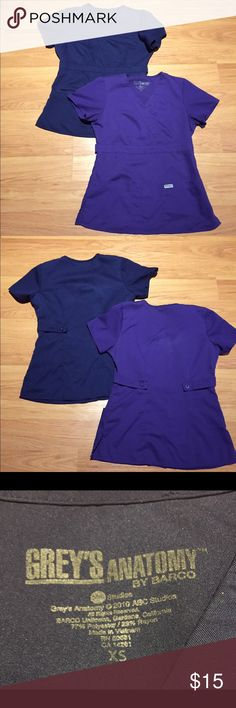 2 Grey's Anatomy scrub tops 2 Grey's Anatomy scrub tops.  Listing is for one navy blue and one purple scrub top.  They have been worn several times but still have a lot of life left in them Grey's Anatomy Tops