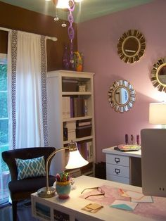 The lighting, the pastel wall, the curtain, and the little cabinet in the corner. Cute!