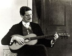 1915. James Joyce playing guitar.