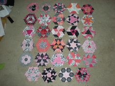 Name:  blocks to date.JPG  The Quilting Board: english paper piecing hexagon hand project- 1st blocks by ckcowl