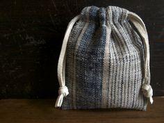cocoon /  nishikawa harue - small drawstring bag of hand-woven fabric:  hand-spun wild silk & nettle + indigo dye / leather string