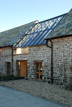Project Portfolio: conversion of an ancient and important heritage Grade II* listed building in Bude, Cornwall. The Bazeley Partnership successfully gained planning permission for our client to Architecture Renovation, Barn Renovation, Modern Architecture, Modern Barn, Modern Farmhouse, Listed Building, Building A House, Glass Roof, Stone Houses
